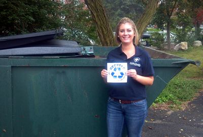 Image of Staphanie Gorman in front of recycling dumpster
