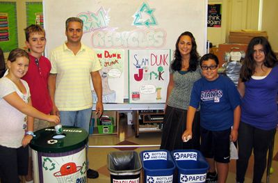 Image of Phil Infantolino poses with some other recycling enthusiasts at a Florham Park school.