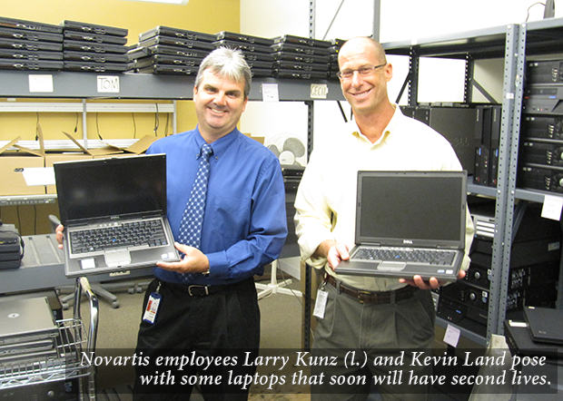 Image Novartis employees Larry Kunz (l.) and Kevin Land pose with some laptops that soon will have second lives.