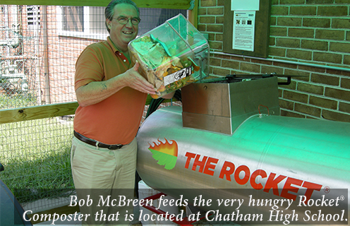 Bob McBreen feeds the very hungry Rocket® Composter that is located at Chatham High School.
