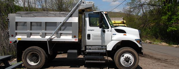 image of compost dump truck