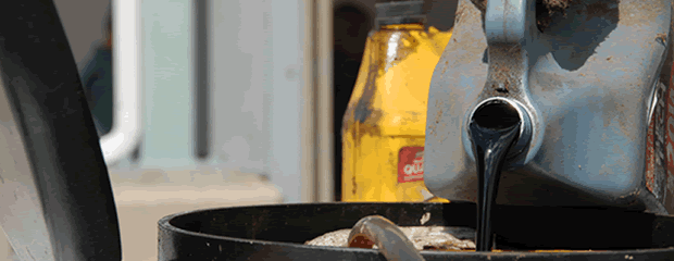 Image of pouring used motor oil