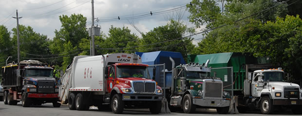 Image of garbage trucks in line
